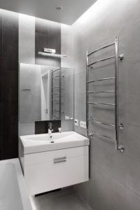 Renovated Small Bathroom showing vanity, towel rack and light grey tiles.