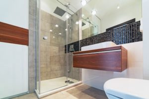 Guest Bathroom Addition showing shower, wooden vanity and large mirror