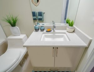 Small bathroom renovations showing vanity, mirror and toilet.