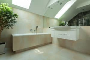 Modern stylish bathroom showing bath, vanity and large mirror