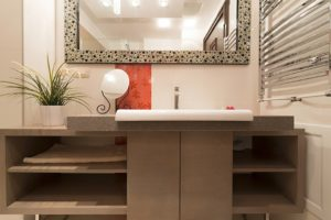 Powder Room showing sink, mirror and towel rack