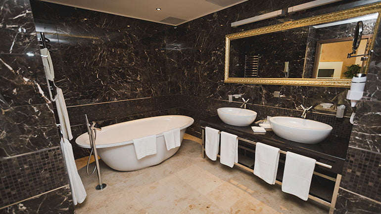 His and her sinks in modern and luxurious ensuite bathroom